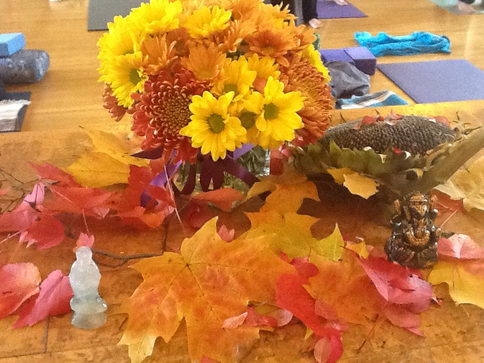 Photo of the altar that some of the students added to each day with colourful leaves and other treasures.